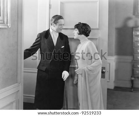 Elegant couple standing in the doorway - stock photo