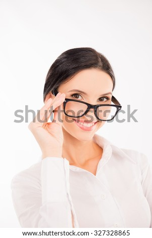 elegant cute businesswoman adjusts her glasses and smiling - stock photo
