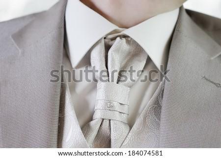 Elegant decoration on man wedding suit - stock photo
