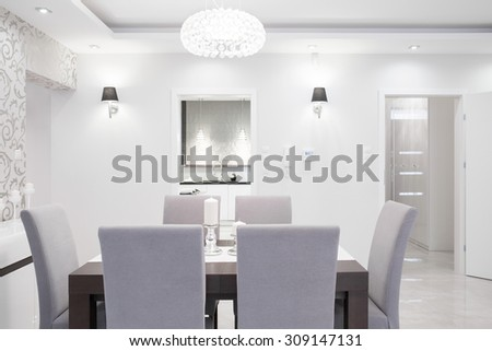 Elegant dining room interior in pastel colors