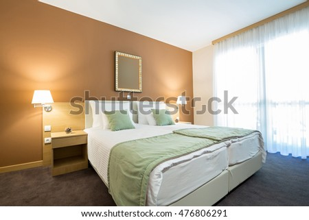 Elegant double bed hotel room interior