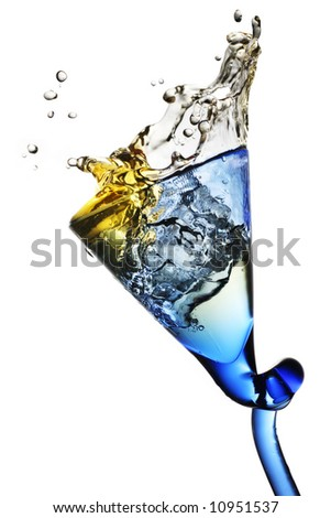 elegant drinking glass with pale colored beverage - stock photo