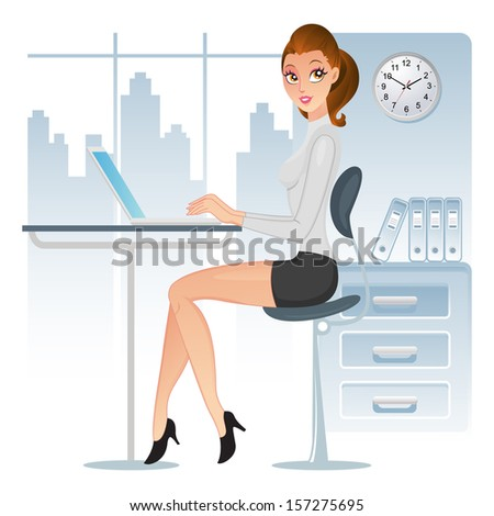 Elegant executive using her laptop in the office - stock photo