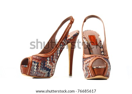 Elegant expensive high heel women shoes. Fetish female weapon. Studio shot. Isolated on white background. - stock photo