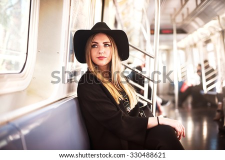 Elegant fashion business woman in the metro - stock photo
