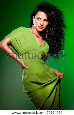 elegant fashionable woman on green - stock photo