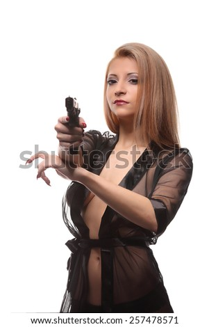 elegant fashionable woman with a gun in hands, studio - stock photo