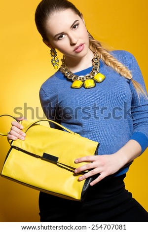 Elegant fashionable woman with bag - stock photo