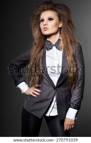 elegant fashionable woman with bow-tie - stock photo