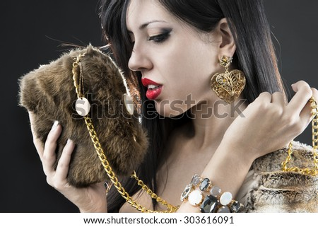 elegant fashionable woman with jewelry and bag - stock photo
