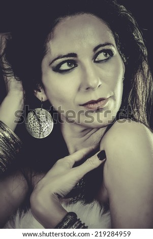 Elegant fashionable woman with silver jewelry - stock photo