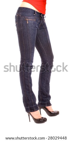 Elegant female legs in jeans and shoes on a heel - stock photo