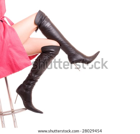 Elegant female legs in leather boots on a heel - stock photo