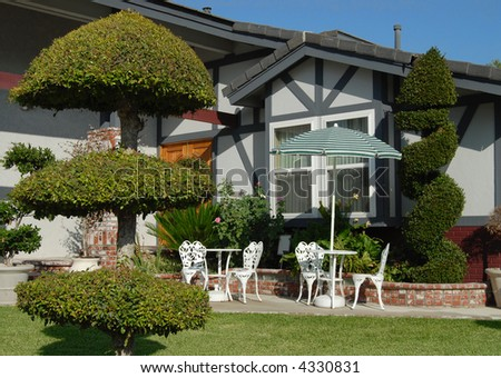 Elegant front yard with decorative shrubs and bushes - stock photo