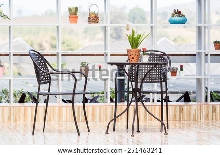 elegant garden furniture on terrace with tables and chairs.