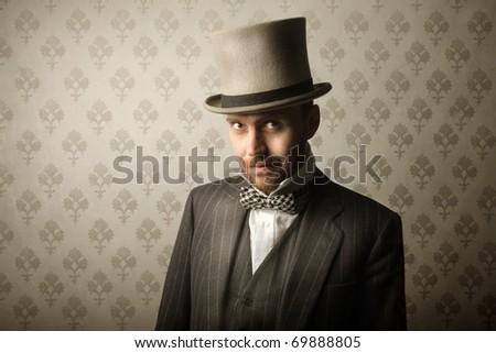 Elegant gentleman wearing a cylinder hat - stock photo