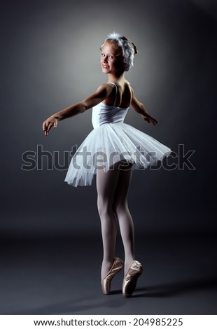 Elegant girl dancing role of White Swan - stock photo