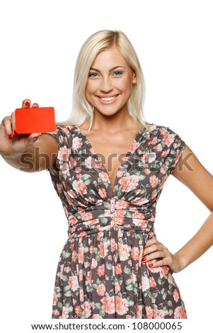 Elegant girl giving you an empty credit card, over white background - stock photo