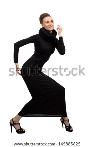 Elegant girl in a black dress on a white background