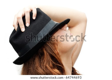Elegant girl in a black hat isolated on white background