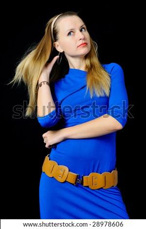 Elegant girl in blue dress, isolated on black - stock photo