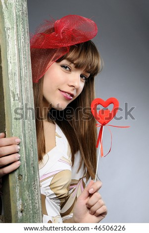 elegant girl showing red heart