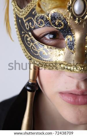 elegant girl with a wonderful mask - stock photo