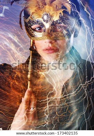 Elegant girl with a wonderful mask surrounded by lightnings - stock photo