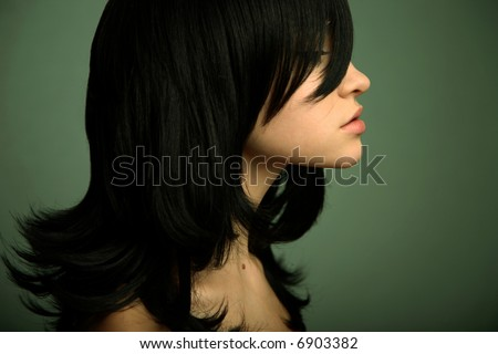 Elegant girl with magnificent black hair. Studio portrait. - stock photo
