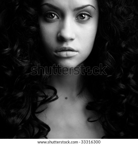 Elegant girl with magnificent curly hair. Studio portrait. - stock photo