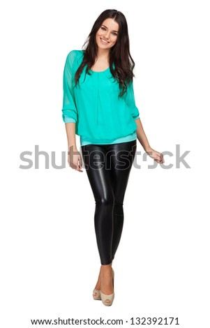 Elegant glamour woman wearing blue blouse and leggins - stock photo