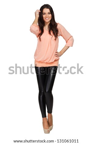 Elegant glamour woman wearing pink blouse and leggins