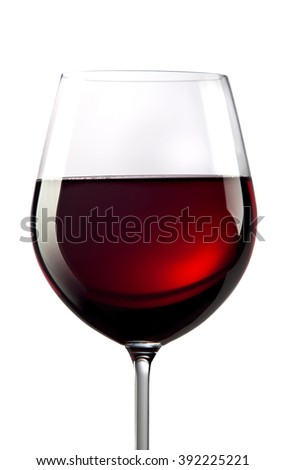 elegant glass of red wine isolated on grey - stock photo
