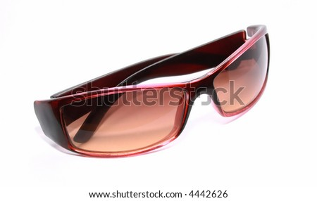 Elegant glasses from the sun on a light background