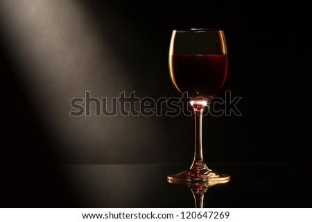 Elegant goblet of red dry wine on dark background - stock photo