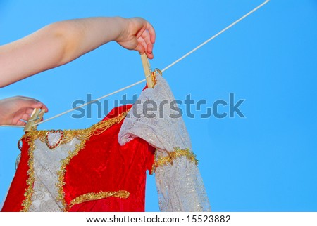 Elegant gown being hung out to dry on clothes line - stock photo