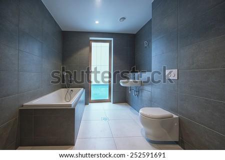 Elegant grey batroom in appartement or hotel - stock photo
