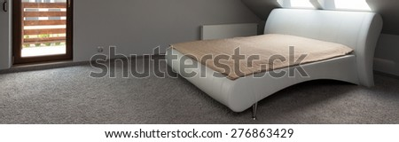 Elegant grey bedroom with comfortable bed, panorama - stock photo