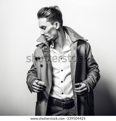 Elegant handsome man in stylish coat. Black-white photo. - stock photo