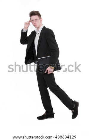 Elegant handsome man in suit with paper document in folder looking at camera. Full body length portrait isolated over white studio background. - stock photo