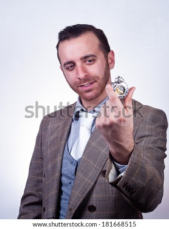 elegant handsome man looking his old pocket watch. - stock photo