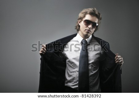 Elegant handsome man undressing - stock photo