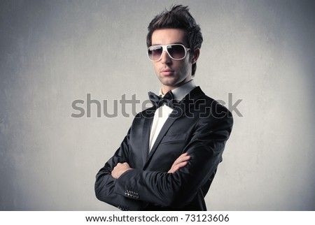 Elegant handsome man wearing sunglasses - stock photo