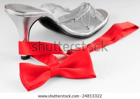 elegant high heeled shoe and red bow tie