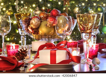 Elegant  holiday table setting with red ribbon gift - stock photo