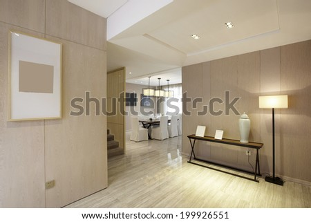 Elegant house interiors,Wide view of home entrance and hallway with dining room in view - stock photo
