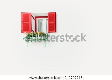 elegant house window with flower - stock photo