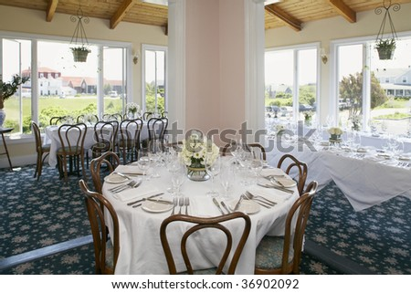 Elegant interior dining room setup for wedding or event - stock photo