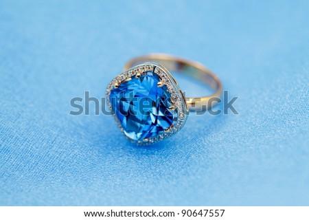 Elegant jewelry ring with jewel stone  blue topaz - stock photo