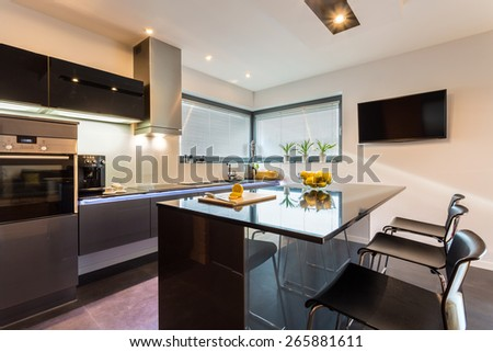 Elegant kitchen and dining interior with silver furniture - stock photo